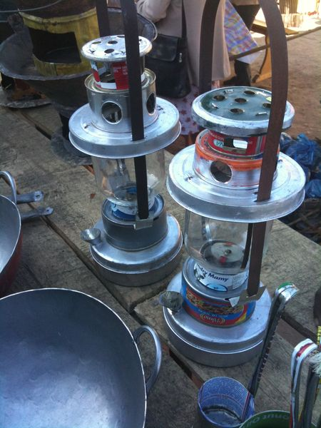 Lanterns that have been up-cycled from discarded food tins.